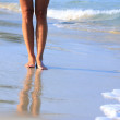 Legs on a beach — Stock Photo