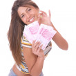 Cheerful young lady holding cash — Stock Photo