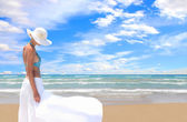 Woman relaxing by the beach — Stock Photo