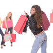 Happy woman with shopping bags - Stockfoto