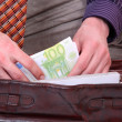 Stock Photo: Mis paying with euro banknotes