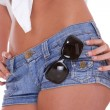 Girl in jeans shorts - Stock Photo