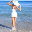 Young woman standing on a beach — Stock Photo #18874921