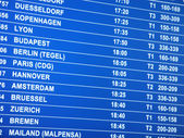 Flights information board in airport — Stock Photo