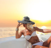 Young sexy woman in white bikini enjoying the sunset — Stock Photo