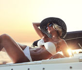 Young sexy woman in white bikini enjoying the sunset — Stok fotoğraf