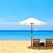 Beds and umbrella on a beach — Stock Photo #20003253