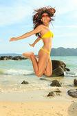 Asian model on the beach — Stockfoto