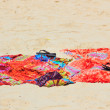 Beach sarong on golden sandy beach — Stock Photo