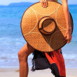 Royalty-Free Stock Photo: Asian model holding a hat  on the beach