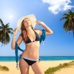 Beautiful woman on the beach. — Stock Photo #21847489