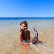 Little girl on a beautiful day at the beach — Stock Photo