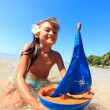 Little girl on a beautiful day at the beach — Stock Photo #22484803