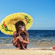 Stock Photo: Ittle girl on beautiful day at beach