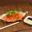 Sliced raw salmon sashimi - Stock Photo