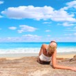 Woman relaxing in the afternoon by the sea — Stock Photo #2353782