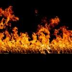 Blazing flames on black background — Stock Photo #23554243