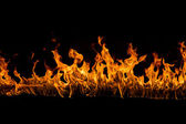 Blazing flames on black background — 图库照片