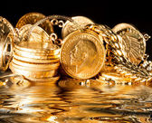 Jewels and gold coins — Stock Photo