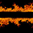 Blazing flames on black background - Foto Stock