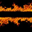 Blazing flames on black background — Stock Photo #23863595