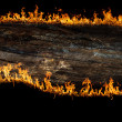 Burning wooden board - Stock Photo