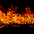 Blazing flames on black background - Stock Photo