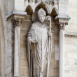 Sculptures of saints of Notre Dame de Paris - Stock Photo