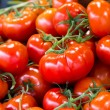 Cherry tomatoes at market - Stock Photo