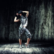 Urban dancer with grunge concrete wall — Stock Photo