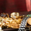 Jewels and gold coins — Stock Photo #24439515
