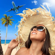 Woman at the beach in tropical resort - Stock Photo