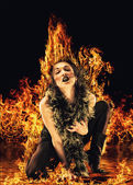 Vampire woman surrounded by fire — Stock Photo