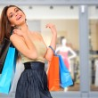 Young woman holding shopping bags - Stockfoto