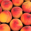 Peaches at the market in Italy - Stock Photo