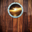 Boat porthole with ocean view — Stock Photo #25107345