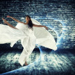 Modern style dancer on dirty background - Stock Photo