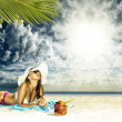 Woman sunbathing on a beach — Stock Photo