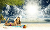 Woman sunbathing on a beach — Stock Photo