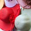 Summer hats in shop window - Stock Photo