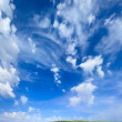 Green grass hills under midday sun - Stock Photo