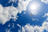 Helicopter flying in the clouds — Stock Photo
