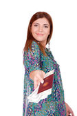 Excited traveler with her passport — Stock Photo
