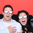 Stock Photo: Couple at home watching a 3D movie