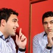 One man, with two faces on the mirror — Stock Photo #25502321