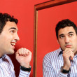 One man, with two faces on the mirror — Stock Photo #25503193