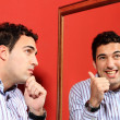 One man, with two faces on the mirror — Stock Photo #25503217