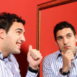 One man, with two faces on the mirror — Stock Photo #25503245