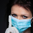 Stock Photo: Young nurse in mask