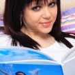 Beautiful girl reads magazine — Stock Photo